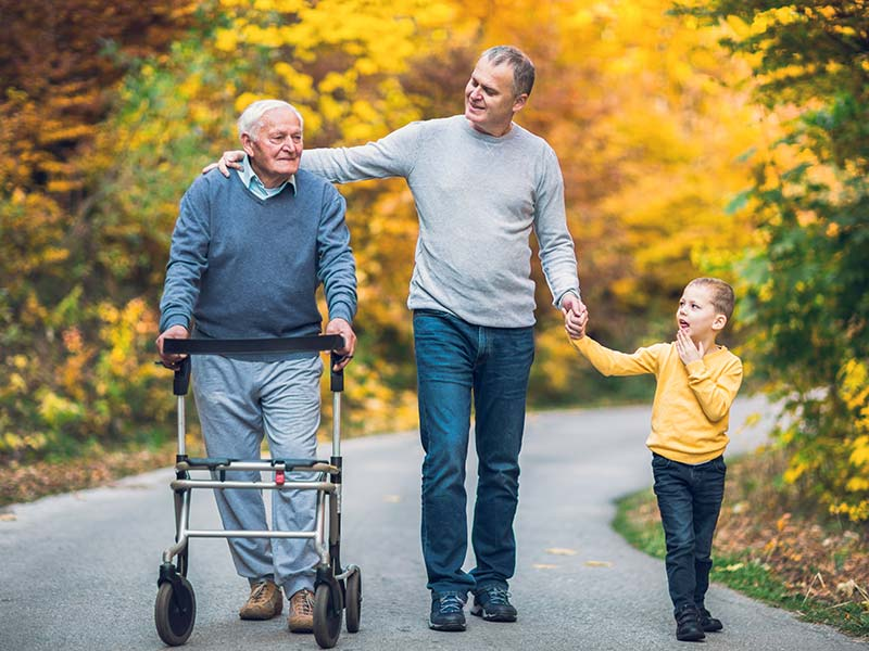 Three generations. Grandfather, father and son taking autumn walk - Unite Lottery